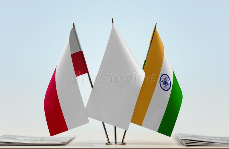 Flags of Poland and India. Desktop flags of Poland and India with white flag between stock photos