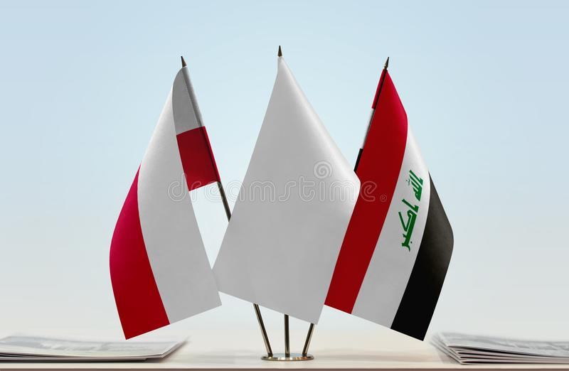 Flags of Poland and Iraq. Desktop flags of Poland and Iraq with white flag between royalty free stock photography