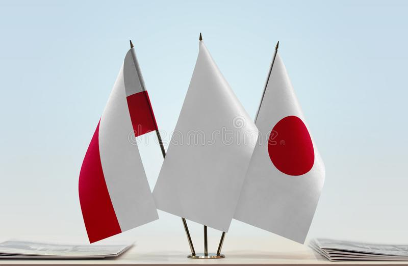 Flags of Poland and Japan. Desktop flags of Poland and Japan with white flag between royalty free stock images