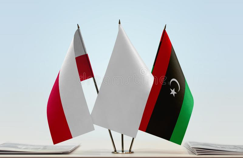 Flags of Poland and Libya stock photo