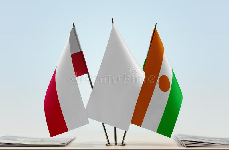 Flags of Poland and Niger stock image