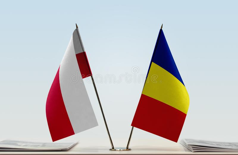 Flags of Poland and Romania. Two table flags of Poland and Romania stock photo
