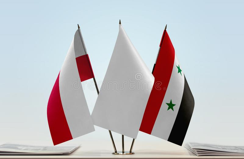 Flags of Poland and Syria. Desktop flags of Poland and Syria with white flag between stock photography