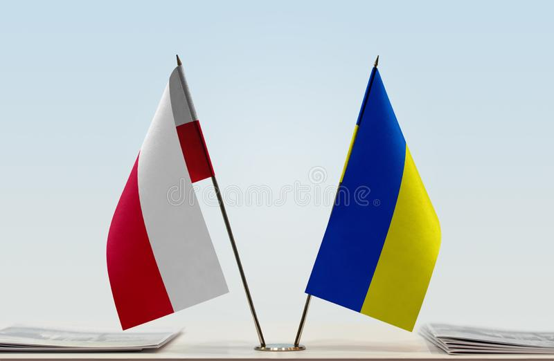 Flags of Poland and Ukraine. Two table flags of Poland and Ukraine stock photo