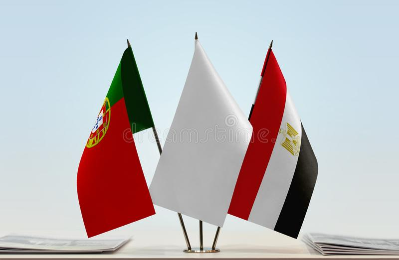 Flags of Portugal and Egypt. Desktop flags of Portugal and Egypt with white flag between stock image