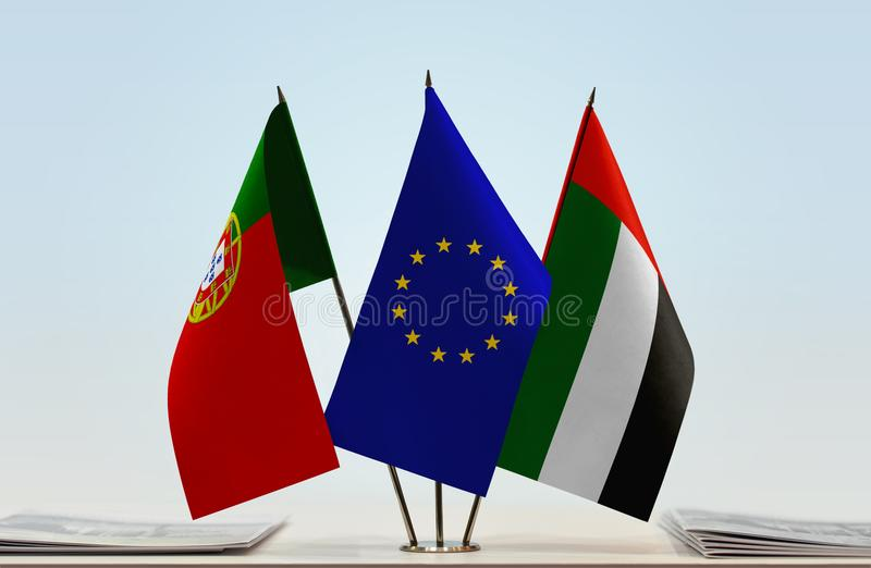 Flags of Portugal EU and UAE. Desktop flags of Portugal and UAE with European Union flag in the middle stock illustration