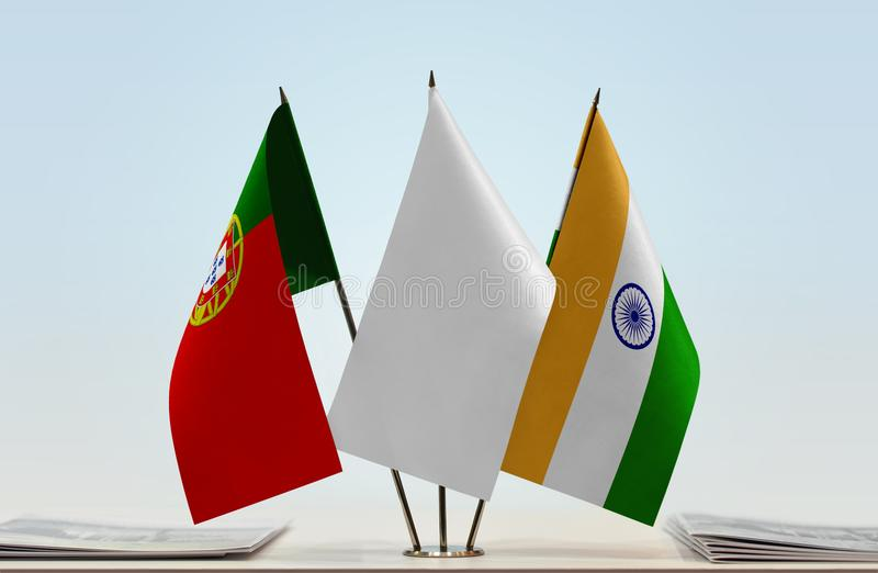 Flags of Portugal and India. Desktop flags of Portugal and India with white flag between royalty free stock photo