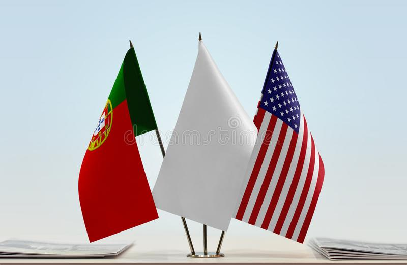 Flags of Portugal and USA. Desktop flags of Portugal and USA with white flag between stock image