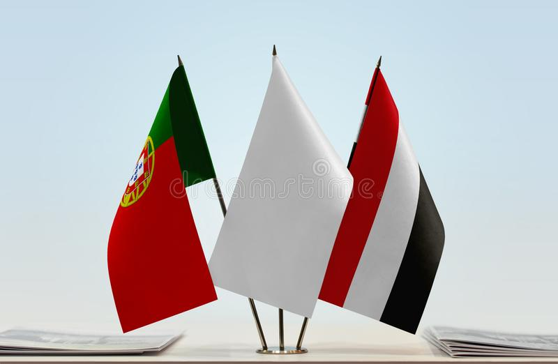 Flags of Portugal and Yemen. Desktop flags of Portugal and Yemen with white flag between stock image