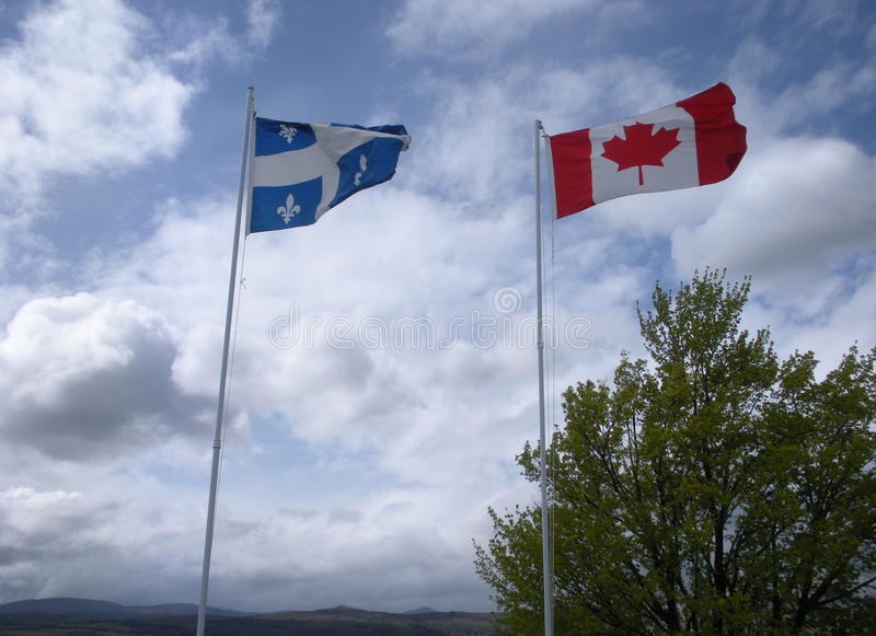 Flags of Quebec and Canada stock photography
