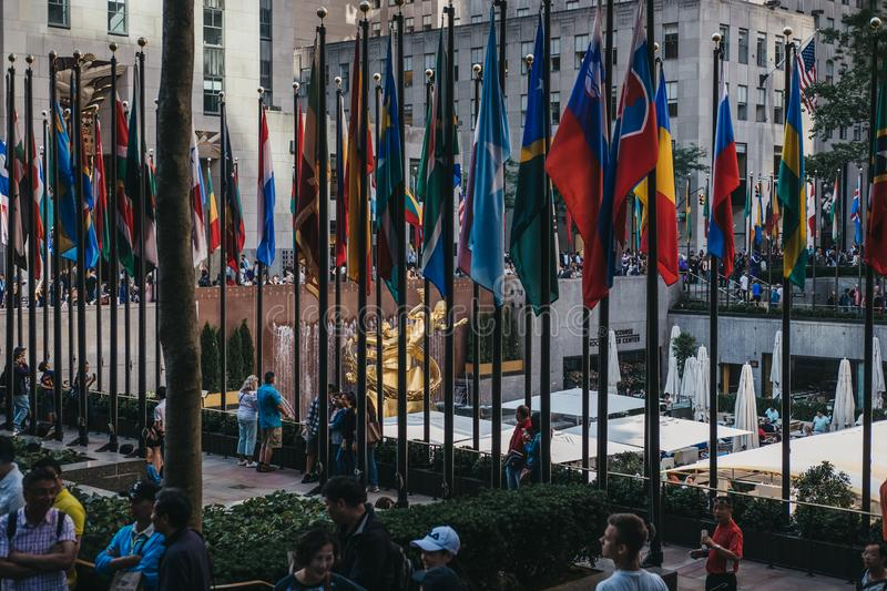 Flags at the Rockefeller Plaza, New York, USA. Flags at the Rockefeller Plaza, New York. Plaza displays flags of United Nations member countries, the U.S royalty free stock images
