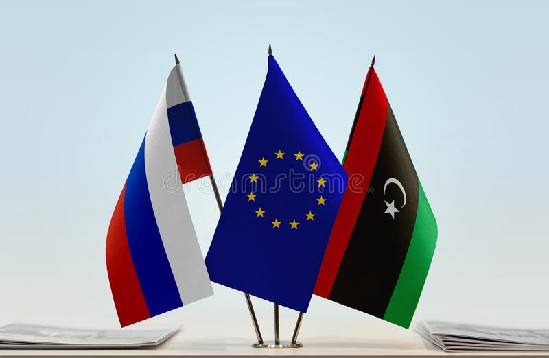 Flags of Russia EU and Libya. Desktop flags of Russia and Libya with European Union flag in the middle vector illustration