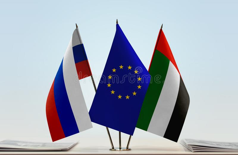 Flags of Russia EU and UAE. Desktop flags of Russia and UAE with European Union flag in the middle vector illustration