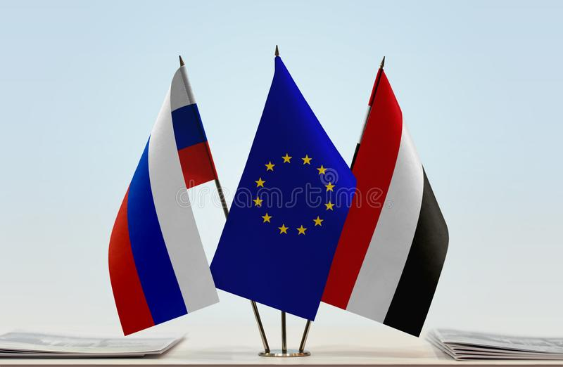 Flags of Russia EU and Yemen. Desktop flags of Russia and Yemen with European Union flag in the middle royalty free illustration