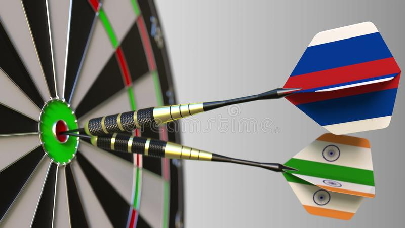 Flags of Russia and India on darts hitting bullseye of the target. International cooperation or competition conceptual. Flags of Russia and India on darts stock photo