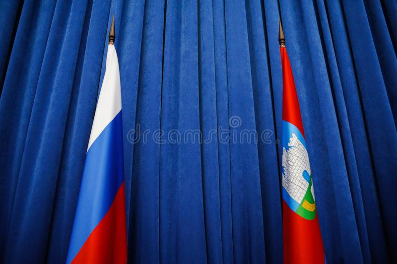 Flags of Russian Federation and orel Region on blue background. Horizontal stock photography