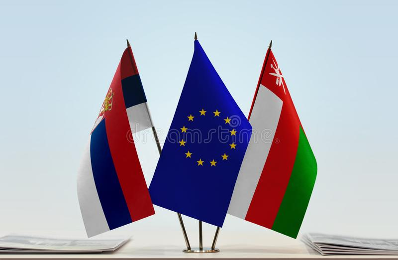 Flags of Serbia EU and Oman. Desktop flags of Serbia and Oman with European Union flag in the middle vector illustration