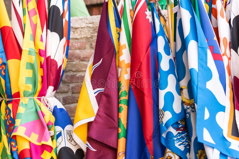 Flags of the Siena contrade districts Palio festival background, in Siena, Tuscany, Italy stock image