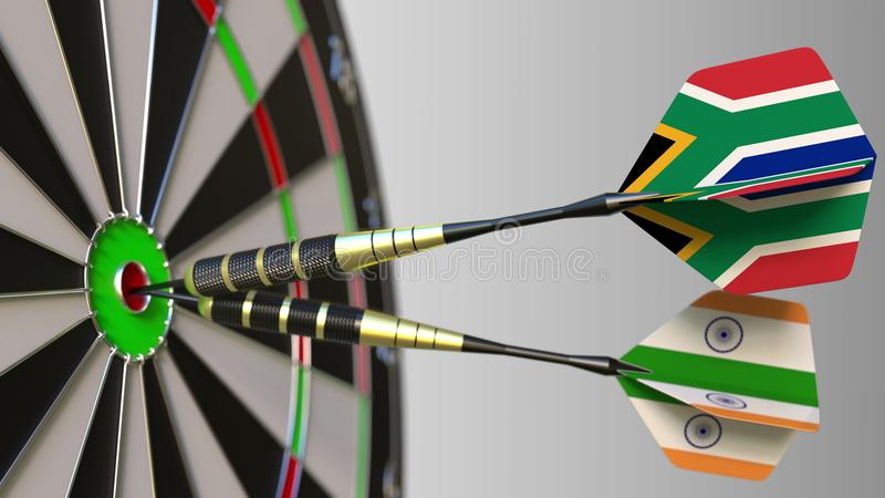 Flags of South Africa and India on darts hitting bullseye of the target. International cooperation or competition. Flags of South Africa and India on darts royalty free stock photos