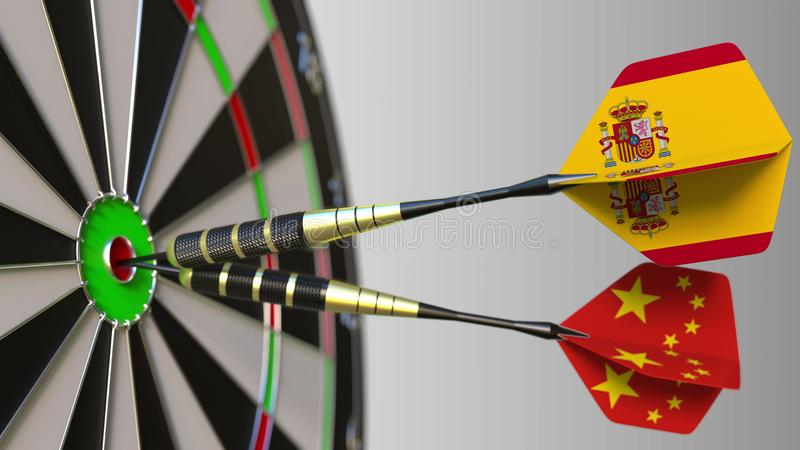 Flags of Spain and China on darts hitting bullseye of the target. International cooperation or competition conceptual 3D. Flags of Spain and China on darts stock photos
