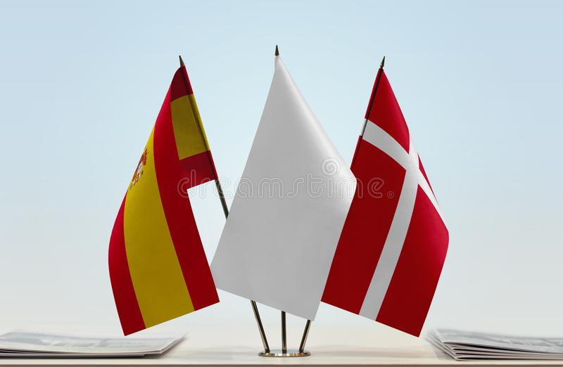 Flags of Spain and Denmark. Desktop flags of Spain and Denmark with a white flag in the middle vector illustration