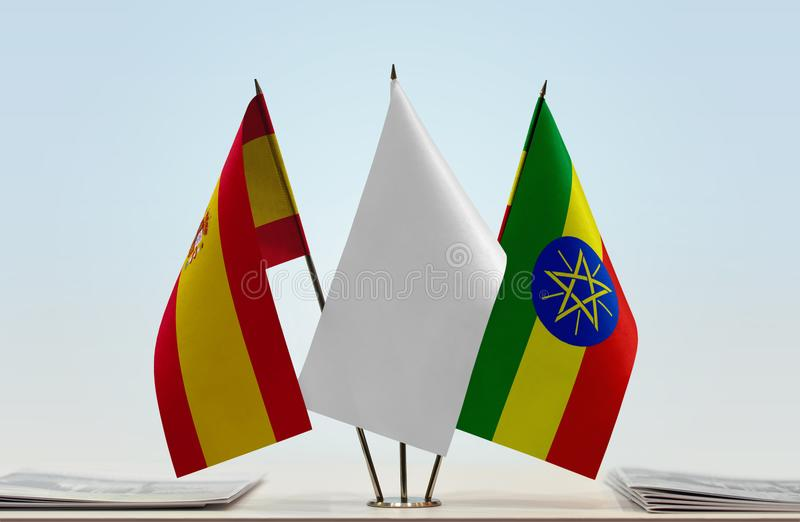 Flags of Spain and Ethiopia. Desktop flags of Spain and Ethiopia with white flag between royalty free stock image