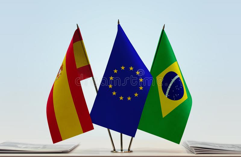 Flags of Spain EU and Brazil. Desktop flags of Spain and Brazil with European Union flag in the middle stock illustration