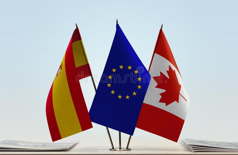 Flags of Spain EU and Canada. Desktop flags of Spain and Canada with European Union flag in the middle vector illustration