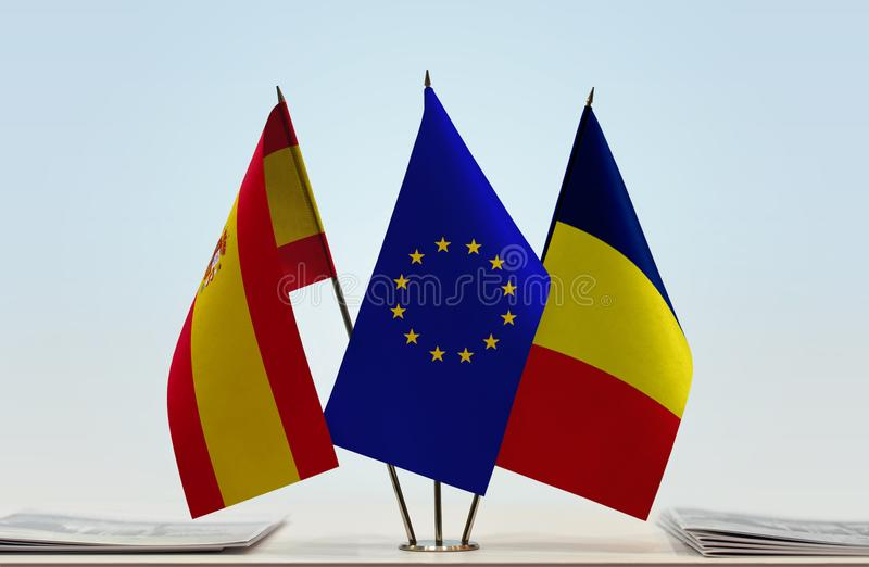 Flags of Spain EU and Chad. Desktop flags of Spain and Chad with European Union flag in the middle royalty free illustration