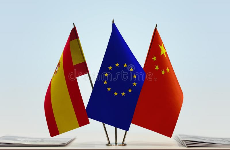 Flags of Spain EU and China. Desktop flags of Spain and China with European Union flag in the middle vector illustration