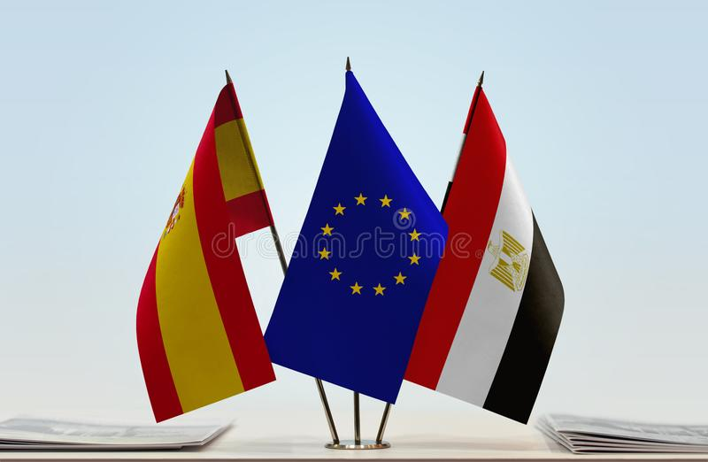 Flags of Spain EU and Egypt. Desktop flags of Spain and Egypt with European Union flag in the middle vector illustration