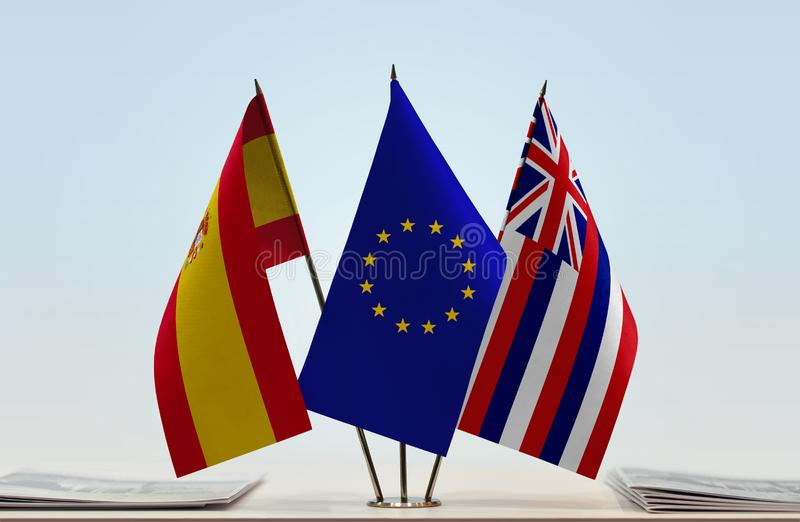 Flags of Spain EU and Hawaii. Desktop flags of Spain and Hawaii with European Union flag in the middle stock illustration