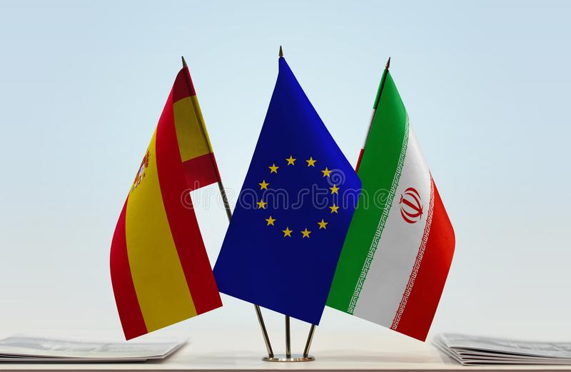 Flags of Spain EU and Iran. Desktop flags of Spain and Iran with European Union flag in the middle royalty free illustration