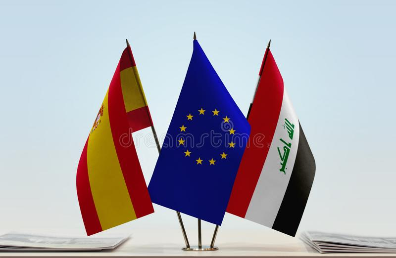 Flags of Spain EU and Iraq. Desktop flags of Spain and Iraq with European Union flag in the middle vector illustration