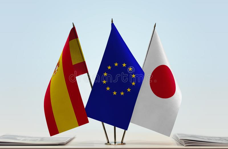 Flags of Spain EU and Japan. Desktop flags of Spain and Japan with European Union flag in the middle stock illustration