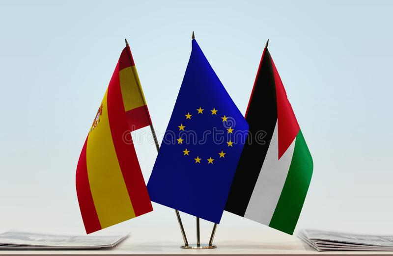 Flags of Spain EU and Jordan. Desktop flags of Spain and Jordan with European Union flag in the middle vector illustration