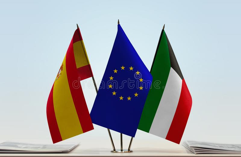 Flags of Spain EU and Kuwait. Desktop flags of Spain and Kuwait with European Union flag in the middle royalty free illustration