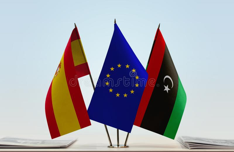 Flags of Spain EU and Libya. Desktop flags of Spain and Libya with European Union flag in the middle stock illustration