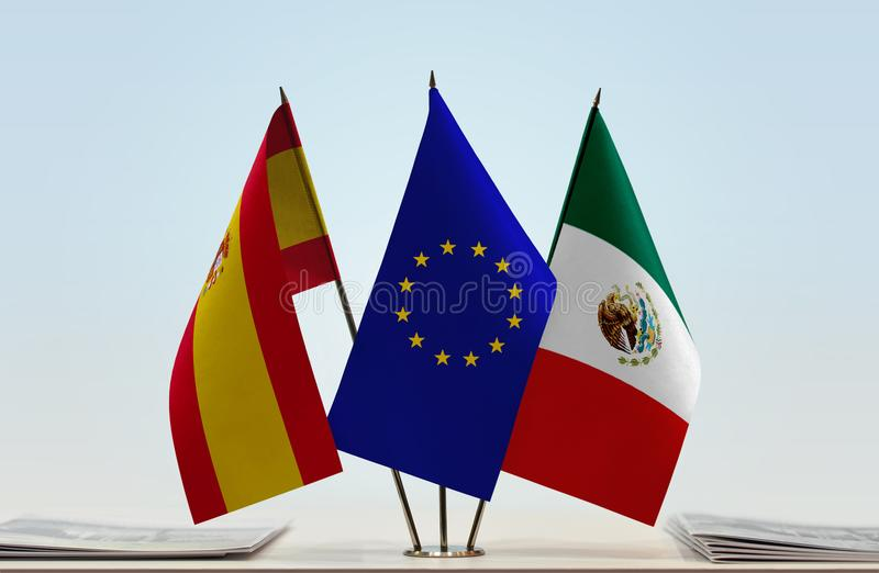 Flags of Spain EU and Mexico. Desktop flags of Spain and Mexico with European Union flag in the middle royalty free illustration