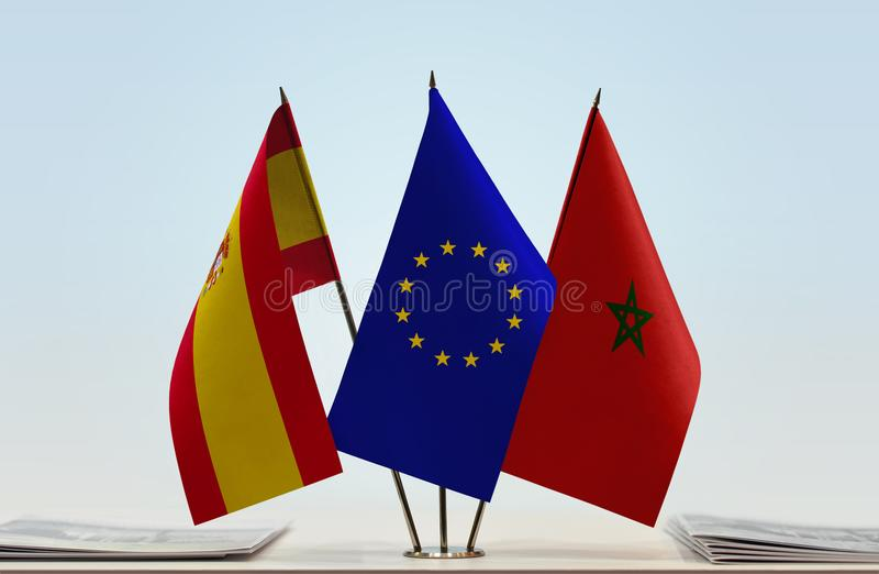 Flags of Spain EU and Morocco. Desktop flags of Spain and Morocco with European Union flag in the middle stock illustration