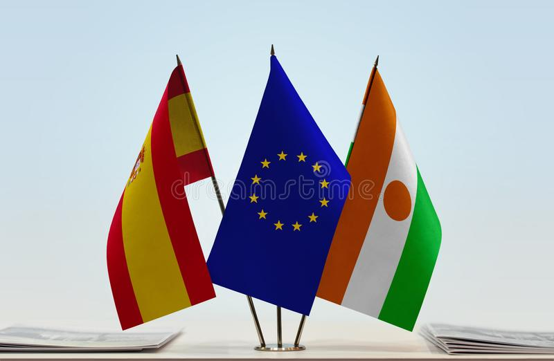 Flags of Spain EU and Niger. Desktop flags of Spain and Niger with European Union flag in the middle stock illustration