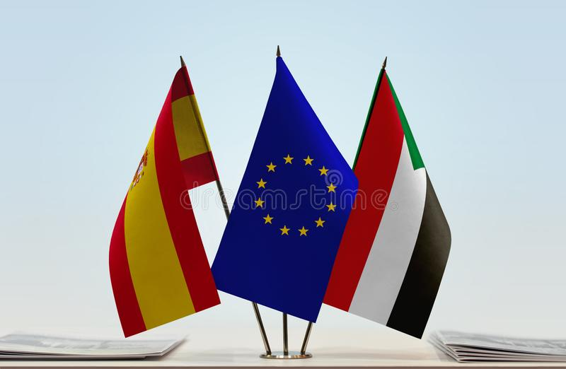 Flags of Spain EU and Sudan. Desktop flags of Spain and Sudan with European Union flag in the middle stock illustration
