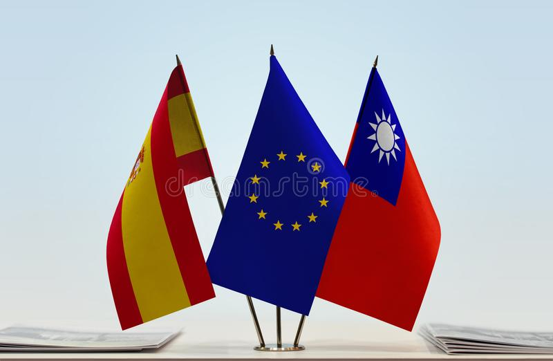 Flags of Spain EU and Taiwan. Desktop flags of Spain and Taiwan with European Union flag in the middle stock illustration