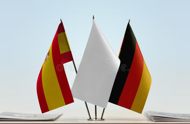 Flags of Spain and Germany. Desktop flags of Spain and Germany with a white flag in the middle stock illustration