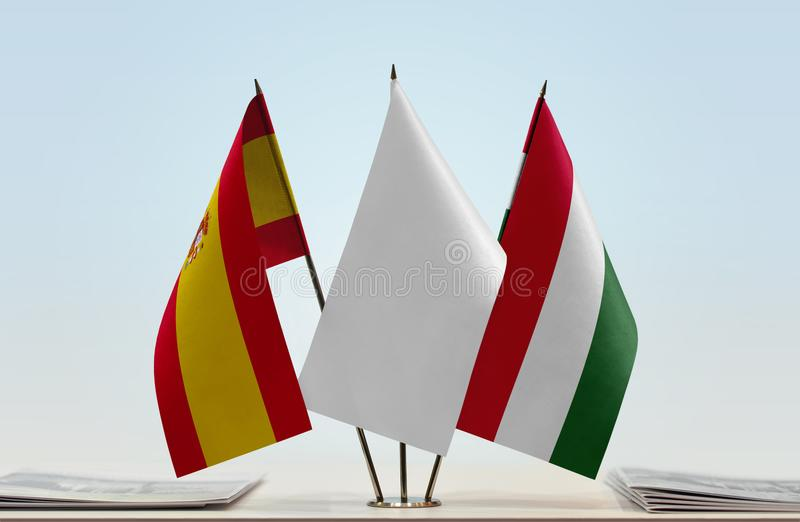 Flags of Spain and Hungary. Desktop flags of Spain and Hungary with a white flag in the middle vector illustration