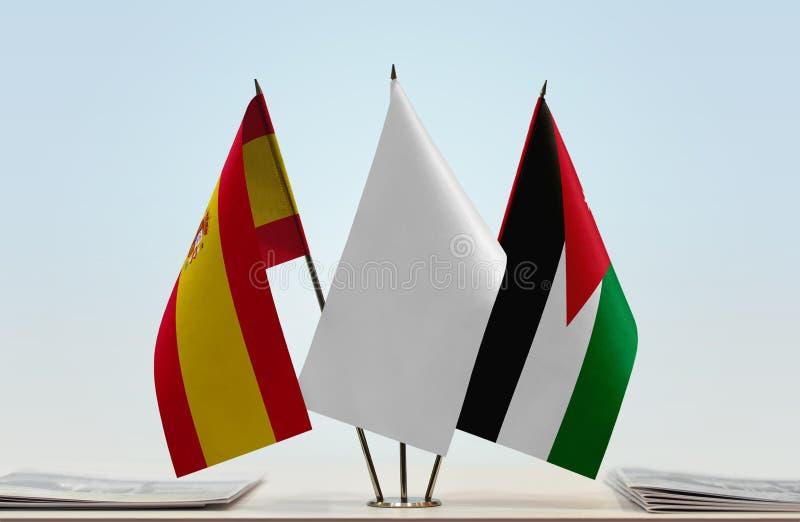 Flags of Spain and Jordan. Desktop flags of Spain and Jordan with white flag between stock image