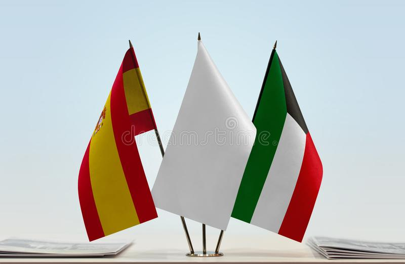 Flags of Spain and Kuwait. Desktop flags of Spain and Kuwait with white flag between stock photo