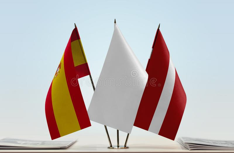 Flags of Spain and Latvia. Desktop flags of Spain and Latvia with a white flag in the middle vector illustration