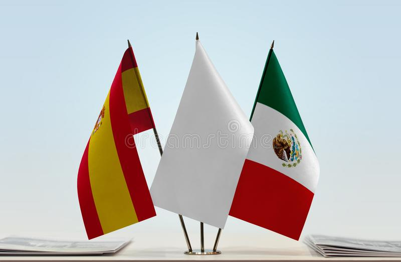 Flags of Spain and Mexico. Desktop flags of Spain and Mexico with white flag between stock image