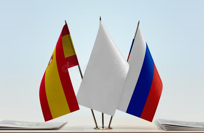 Flags of Spain and Russia. Desktop flags of Spain and Russia with a white flag in the middle vector illustration